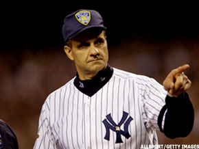 New York Yankees manager Joe Torre wears a Port Authority police hat on  Sept. 25 593db41ff03